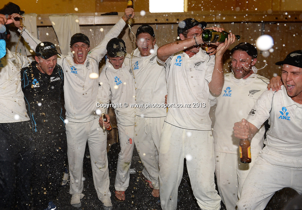 New Zealand players celebrate in the dressing room on Day 3 of the 2nd cricket test match of the ANZ Test Series. New Zealand Black Caps v West Indies at The Basin Reserve in Wellington. Friday 13 December 2013. Mandatory Photo Credit: Andrew Cornaga www.Photosport.co.nz