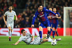 Lionel Messi of Barcelona skips over a challenge from Andreas Christensen of Chelsea - Mandatory by-line: Matt McNulty/JMP - 14/03/2018 - FOOTBALL - Camp Nou - Barcelona, Catalonia - Barcelona v Chelsea - UEFA Champions League - Round of 16 Second Leg