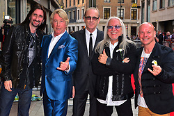 Bula Quo UK film premiere.  <br /> Rick Parfitt, Francis Rossi (second and third from left) and Uriah Heep attend premiere of Status Quo action film featuring 12 of the rock band's classic tracks. Directed by former stunt co-ordinator Stuart St Paul, starring Jon Lovitz, Craig Fairbrass, Laura Aikman and the band members themselves. Released July 5. Odeon West End, London, United Kingdom.<br /> Monday, 1st July 2013<br /> Picture by Nils Jorgensen / i-Images