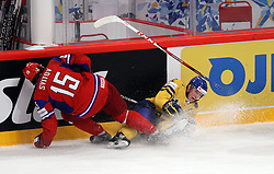 11.05.2012, Ericsson Globe, Stockholm, SWE, IIHF, Eishockey WM, Russland (RUS) vs Schweden (SWE), im Bild Russia 15 Alexander Svitov (Salavat Yuayev Ufa) and Sverige Sweden 32 Marcus Kruger collides at the boards // during the IIHF Icehockey World Championship Game between Russia (RUS) and Sweden (SWE) at the Ericsson Globe, Stockholm, Sweden on 2012/05/11. EXPA Pictures © 2012, PhotoCredit: EXPA/ PicAgency Skycam/ Morten Christensen..***** ATTENTION - OUT OF SWE *****