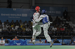 "October 9, 2018 - Buenos Aires, Buenos Aires, Argentina - T M.M. AMADOU of Nigeria and JOSE ACU""A of Argentina compete during the Men'sTakewondo -55Kg Quaterfinals on Day 2 of the Buenos Aires 2018 Youth Olympic Games at the Olympic Park. (Credit Image: © Patricio Murphy/ZUMA Wire)"