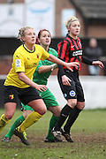 Kirsty Barton, Holly Wride and Cherie Rowlands anticipate the incoming corner during the Women's FA Cup match between Watford Ladies FC and Brighton Ladies at the Broadwater Stadium, Berkhampstead, United Kingdom on 1 February 2015. Photo by Stuart Butcher.