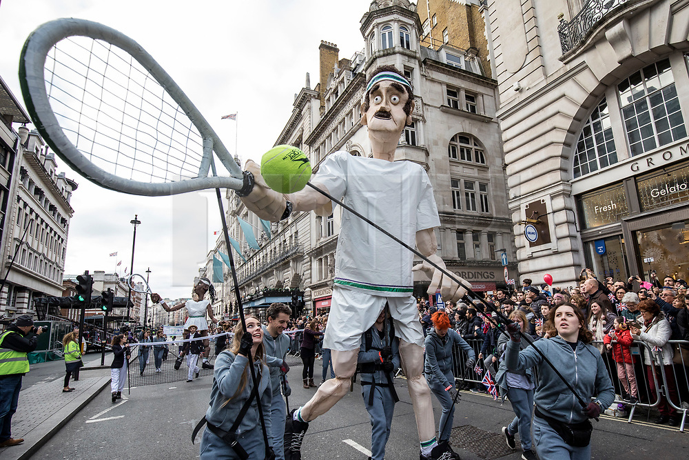 © Licensed to London News Pictures. 01/01/2019. London, UK. A large puppet of Andy Murray playing tennis during the London New Year's Day Parade. More than 8,000 performers from 26 countries are taking part in the parade. Photo credit: Rob Pinney/LNP