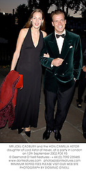 MR JOEL CADBURY and the HON.CAMILLA ASTOR daughter of Lord Astor of Hever, at a party in London on 12th September 2002.	PDE 93