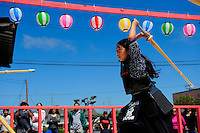 """Seven year-old Kha-Ai Pham shows her sword skills at a """"kendo"""" demonstration at the 2012 Obon Festival at the Buddhist Temple of Salinas."""