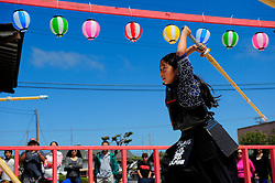 "Seven year-old Kha-Ai Pham shows her sword skills at a ""kendo"" demonstration at the 2012 Obon Festival at the Buddhist Temple of Salinas."