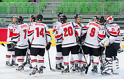 Players of Austria celebrate after the ice-hockey match between Austria and Great Britain at IIHF World Championship DIV. I Group A Slovenia 2012, on April 16, 2012 in Arena Stozice, Ljubljana, Slovenia. Austria defeated Great Britain 6-3. (Photo by Vid Ponikvar / Sportida.com)