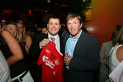 LIVERPOOL, ENGLAND - WEDNESDAY, JUNE 9th, 2005: Liverpool FC Legend Kenny Dalglish with the winning bidder of his auction shirt during the Players Party at the St Thomas Hotel during the 4th Liverbird Developments Liverpool International Tennis Tournament. (Pic by Dave Rawcliffe/Propaganda)