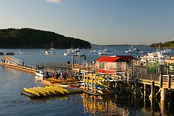 Sea kayaks on the municipal pier in Bar Harbor Maine USA
