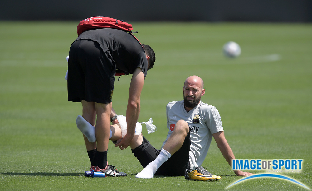 Apr 10, 2018; Los Angeles, CA, USA; A trainer applies ice to the knee of LAFC defender Laurent Ciman at practice at Cal State LA.