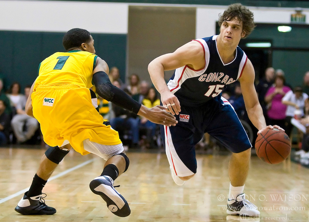 January 30, 2010; San Francisco, CA, USA;  Gonzaga Bulldogs guard Matt Bouldin (15) is guarded by San Francisco Dons guard Kwame Vaughn (1) during the second half at the War Memorial Gym.  San Francisco defeated Gonzaga 81-77 in overtime.