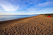 The long stretch of pebble beach at Slapton Sands, South Hams, Devon. Camping is allowed on beaches in South Hams at the discretion of the beach owner.
