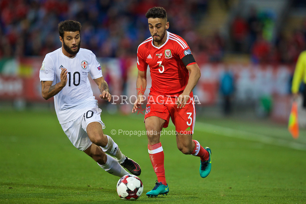 CARDIFF, WALES - Sunday, October 9, 2016: Wales' Neil Taylor in action against Georgia's Tornike Okriashvili during the 2018 FIFA World Cup Qualifying Group D match at the Cardiff City Stadium. (Pic by David Rawcliffe/Propaganda)