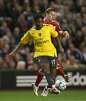 Photo: Paul Thomas.<br /> Liverpool v Arsenal. Carling Cup. 09/01/2007.<br /> <br /> Goal scorer Alexandre Song battles with Craig Bellamy (R) of Liverpool.
