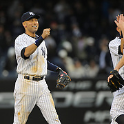 Derek Jeter, (left), congratulates Shawn Kelley, who closed the game for the New York Yankees during the New York Yankees V Baltimore Orioles home opening day at Yankee Stadium, The Bronx, New York. 7th April 2014. Photo Tim Clayton