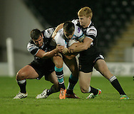 Josh Bowden (left) &amp; James Cunningham of Hull Football Club tackle Tom Briscoe of Leeds Rhinos during the First Utility Super League match at KC Stadium, Hull<br /> Picture by Richard Gould/Focus Images Ltd +44 7855 403186<br /> 12/09/2014