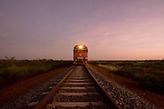 The Ghan.  Sunrise at 6.30am approximately 80kms south of Tennant Creek in the Australian outback.  Northern Territory, Australia. Image © Arsineh Houspian/Falcon Photo Agency.