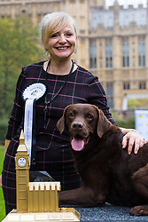 London, October 26 2017. Champions Tracy Barbin MP and her Labrador Rocky pose for pictures at the annual Kennel Club and Dogs Trust Westminster Dog Of The Year competition that sees MPs and members of the House of Lords with their dogs as well as rescue dogs from the Dogs Trust. © Paul Davey