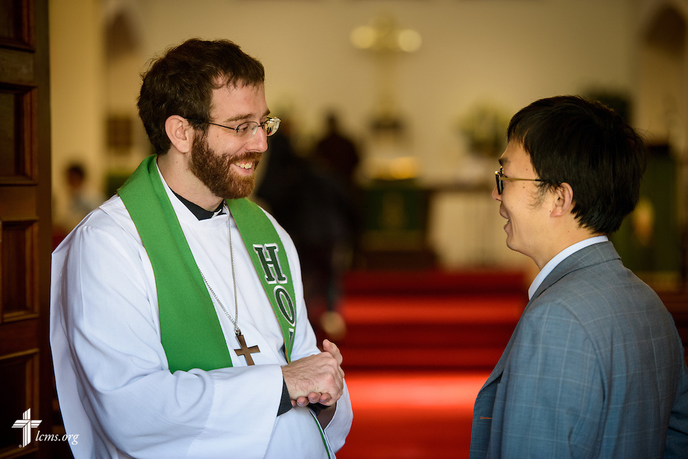 The Rev. Andrew Schlund, LCMS missionary to Mexico, greets Jacob Xiando Luo following worship at the Lutheran Church of The Good Shepherd on Sunday, Jan. 15, 2017, in Mexico City. LCMS Communications/Erik M. Lunsford
