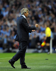 Manchester City Manager, Manuel Pellegrini celebrates Manchester City's second goal  - Photo mandatory by-line: Joe Meredith/JMP - Tel: Mobile: 07966 386802 19/08/2013 - SPORT - FOOTBALL - Etihad Stadium - Manchester - Manchester City V Newcastle United - Barclays Premier League
