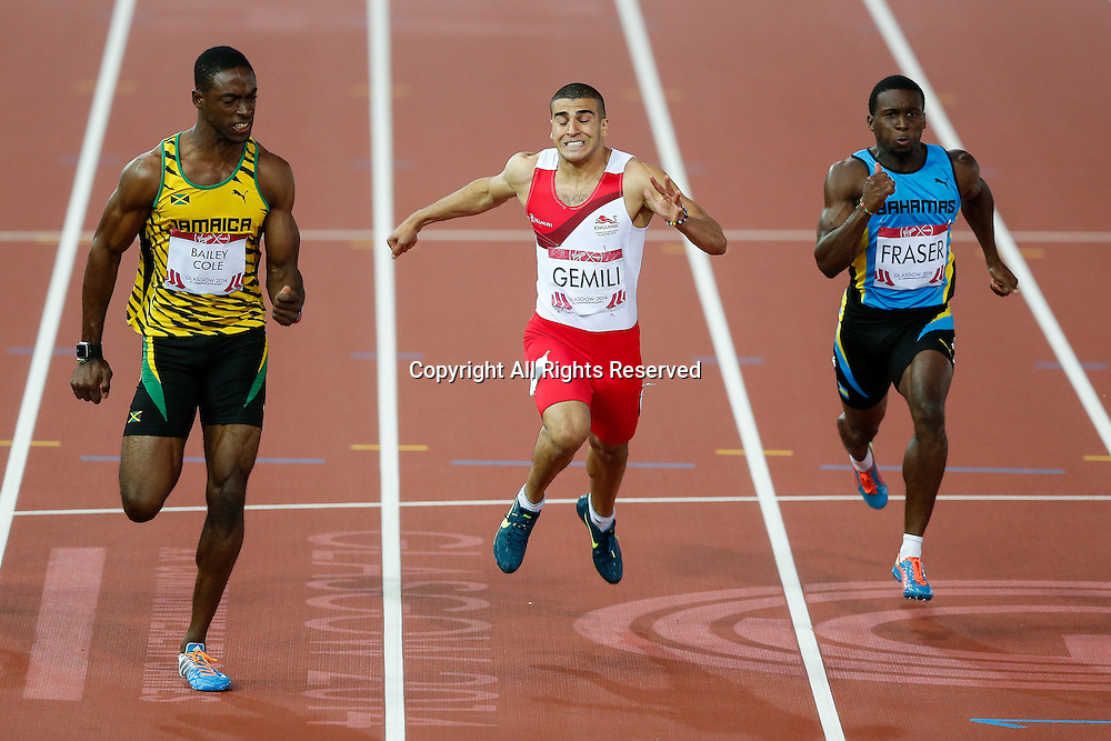 28.07.2014. Glasgow, Scotland. Glasgow 2014 Commonwealth Games Day 5. Athletics, Track and Field. Adam Gemini of England is beaten into second place by winner Kemar Bailey-Cole of Jamaica (left) in the Mens 100m Final.
