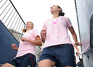The United States' Marian Dalmy (l) and Kate Markgraf (r) take the field for warmups wearing special pink Breast Cancer Awareness tops on Saturday, May 12th, 2007 at Pizza Hut Park in Frisco, Texas. The United States Women's National Team defeated Canada 6-2 in a women's international friendly.