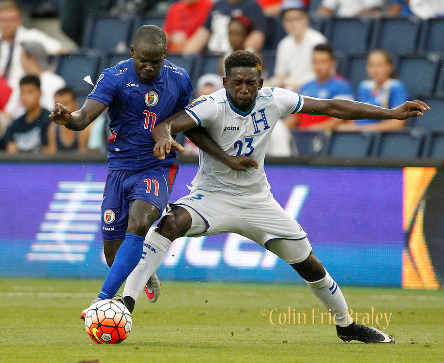Haiti midfielder Pascal Millen (11) steals the ball away from Honduras defender Johnny Palacios (23) during the second half of a CONCACAF Gold Cup soccer match, Monday, July. 13, 2015, in Kansas City, Kan. Haiti beat Honduras 1-0. (AP Photo/Colin E. Braley)
