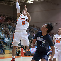 Seth Manuelito (5) of Gallup scores on a layup as he drives past Adrian Destea (12) of Window Rock on the fast break during the Gallup Invitational Tournament game in Gallup. Gallup won 64-42.