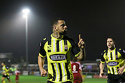 Kyle Vassell celebrates his goal during the The FA Cup 2nd round replay match between Whitehawk FC and Dagenham and Redbridge at The Enclosed Ground, Whitehawk, Brighton, United Kingdom on 16 December 2015. Photo by Ellie Hoad.