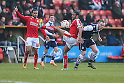 Swindon defender Nathan Thompson & Millwall FC forward Aiden O'Brien (22) tussle with the ball during the Sky Bet League 1 match between Swindon Town and Millwall at the County Ground, Swindon, England on 12 March 2016. Photo by Shane Healey.