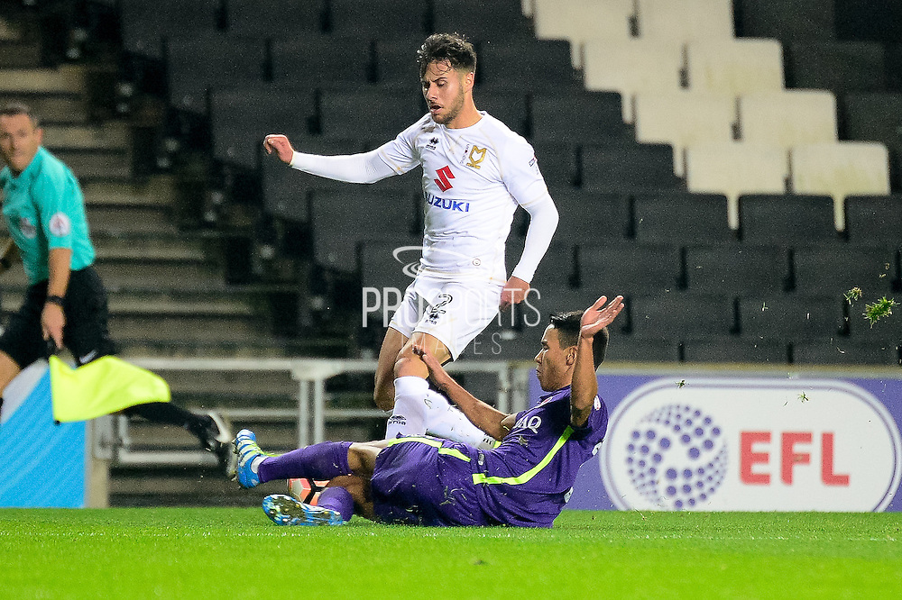 Milton Keynes Dons defender George B Williams (12) is tackled by Charlton Athletic defender Adam Chicksen (3) during the The FA Cup 2nd round replay match between Milton Keynes Dons and Charlton Athletic at stadium:mk, Milton Keynes, England on 13 December 2016. Photo by Dennis Goodwin.