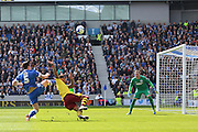Burnley striker Andre Gray (7) shoots at goal during the Sky Bet Championship match between Brighton and Hove Albion and Burnley at the American Express Community Stadium, Brighton and Hove, England on 2 April 2016. Photo by Phil Duncan.