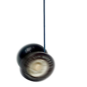 Digitally enhanced image of a spinning black and white yoyo on white background