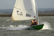 Two young boys sailing a Laser yacht in 18 knots of breeze on the River Hamble. United Kingdom.