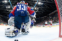 Belarus scores a goal, Robert Kristan, goalkeeper of Slovenia and a puck during ice-hockey match between Slovenia and Belarus of Group G in Relegation Round of IIHF 2011 World Championship Slovakia, on May 8, 2011 in Orange Arena, Bratislava, Slovakia. (Photo by Matic Klansek Velej / Sportida)