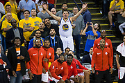 Dawson Gurley aka Fake Klay Thompson reacts to a call behind the Houston Rockets bench during Game 4 of the Western Conference Finals against the Golden State Warriors at Oracle Arena in Oakland, Calif., on May 22, 2018. (Stan Olszewski/Special to S.F. Examiner)