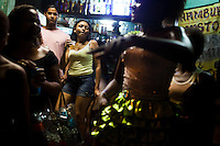 Residents party in the streets during Carnaval in Rocinha, the biggest favela in Brazil, with over 100,000 residents, in Rio de Janeiro, Br., on Thursday, Jan. 24, 2013. In early November 2011 about 3,000 police officers and soldiers moved into one of the largest slums in Latin America in an effort by the Brazilian government to assert control over lawless areas of the city ahead of the 2014 World Cup and 2016 Summer Olympics.
