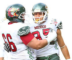 08.07.2011, Tivoli Stadion, Innsbruck, AUT, American Football WM 2011, Group A, Germany (GER) vs Mexico (MEX), im Bild Moreno Noel francisco (Mexico, #66, OL) and Ruíz  Oscar (Mexico, #85, WR) celebrating after a touchdown // during the American Football World Championship 2011 Group A game, Germany vs Mexico, at Tivoli Stadion, Innsbruck, 2011-07-08, EXPA Pictures © 2011, PhotoCredit: EXPA/ T. Haumer