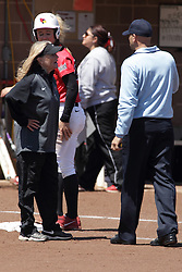 26 April 2015:   Melinda Fischer challenges third base umpire Kelly Ternes about a call he just made during an NCAA Missouri Valley Conference (MVC) Championship series women's softball game between the Loyola Ramblers and the Illinois State Redbirds on Marian Kneer Field in Normal IL