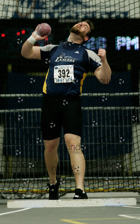 (Windsor, Ontario---13 March 2010) Mike Miller of University of Windsor Lancers   competes in the men's shot put at the 2010 Canadian Interuniversity Sport Track and Field Championships at the St. Denis Center. Photograph copyright Julie Robins/Mundo Sport Images. www.mundosportimages.com