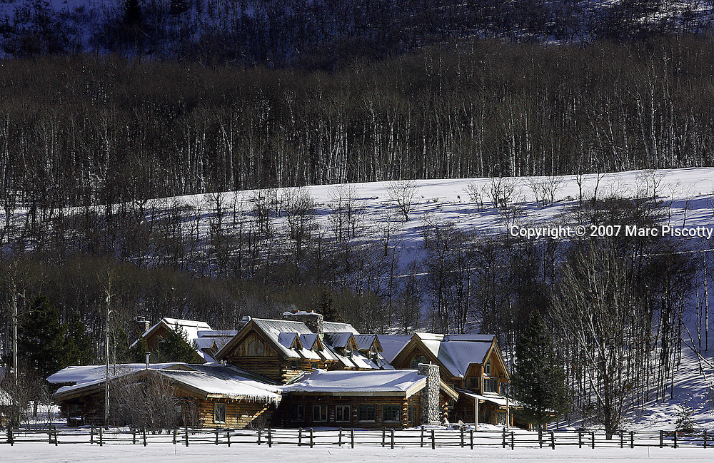 The main lodge house of the Home Ranch in Clark, Co. sits tucked into an aspen covered hillside and under a fresh blanket of snow on Friday February 2, 2007. The main lodge has 6 rooms as well as communal space and the dining area and kitchen. The 1,500 acre Home Ranch in Clark, Colo. is a high-end dude ranch by summer and a cross country skiing and snowshoeing paradise in the winter. The Home Ranch also welcomes guests with world-class dining at the all-inclusive ranch near Steamboat Springs. The ranch has been open since 1980 and rates in the winter range from $420/night for a room in the lodge to $525/night for a cabin..(MARC PISCOTTY/ © 2007)