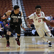 Malik Ellison, (right), St. John's, drives past Michael Carrera, South Carolina, during the St. John's vs South Carolina Men's College Basketball game in the Hall of Fame Shootout Tournament at Mohegan Sun Arena, Uncasville, Connecticut, USA. 22nd December 2015. Photo Tim Clayton