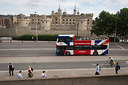 A tour bus with The Original Tour drives past the Tower of London, on 7th July 2017, in the City of London.