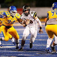 Thomas Wells | Buy at PHOTOS.DJOURNAL.COM<br /> Hernando quarterback Robert Wilcke tries to escape the pressure from the Tupelo defense in the second quarter of Friday's game.