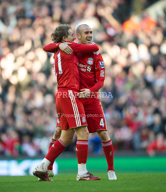 LIVERPOOL, ENGLAND - Saturday, February 12, 2011: Liverpool's Raul Meireles celebrates scoring the opening goal against Wigan Athletic with team-mate Lucas Leiva during the Premiership match at Anfield. (Photo by David Rawcliffe/Propaganda)