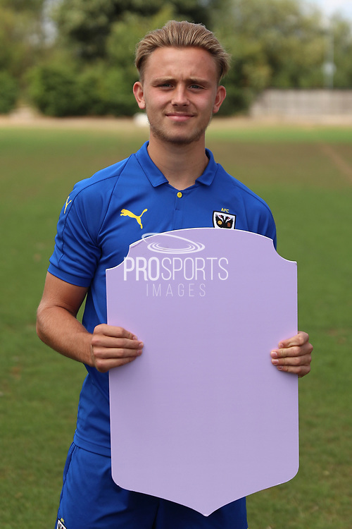 AFC Wimbledon defender Tom Scott (23) holding Fifa sign during the AFC Wimbledon 2018/19 official photocall at the Kings Sports Ground, New Malden, United Kingdom on 31 July 2018. Picture by Matthew Redman.