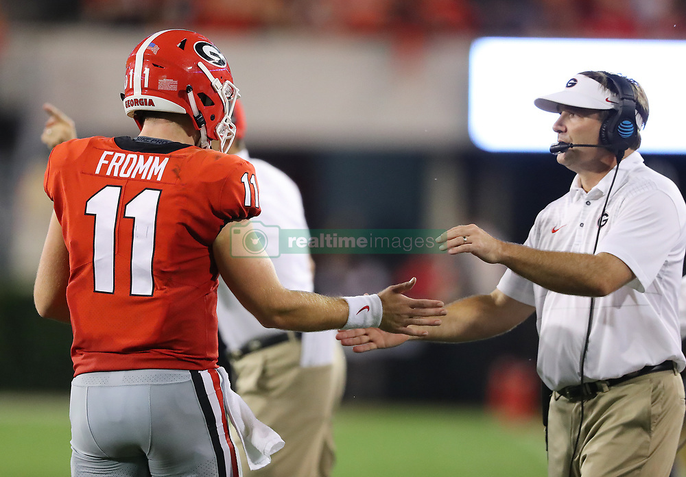 September 16, 2017 - Athens, GA, USA - Georgia quarterback Jake Fromm (11) is congratulated by head coach Kirby Smart after his touchdown pass to wide receiver Terry Godwin for a 21-0 lead during the second quarter against Samford on Saturday, Sept. 16, 2017, at Sanford Stadium in Athens, Ga. (Credit Image: © Curtis Compton/TNS via ZUMA Wire)