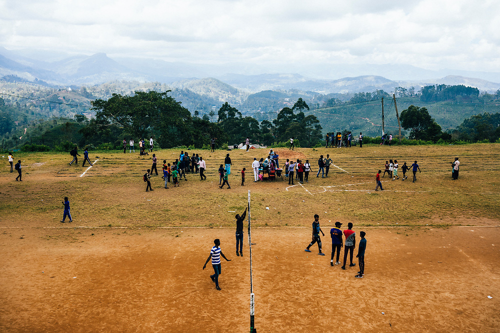 Hapatule, Sri Lanka -- February 3, 2018: School children play in a field overlooking the vast mountains of upper hill country.