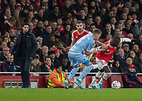 Football - 2019 /2020 FA Cup - Third Round: Arsenal vs. Leeds United.<br /> <br /> Barry Douglas (Leeds United) holds back the run of Nicolas Pepe (Arsenal FC) at the Emirates Stadium<br /> <br /> COLORSPORT/DANIEL BEARHAM