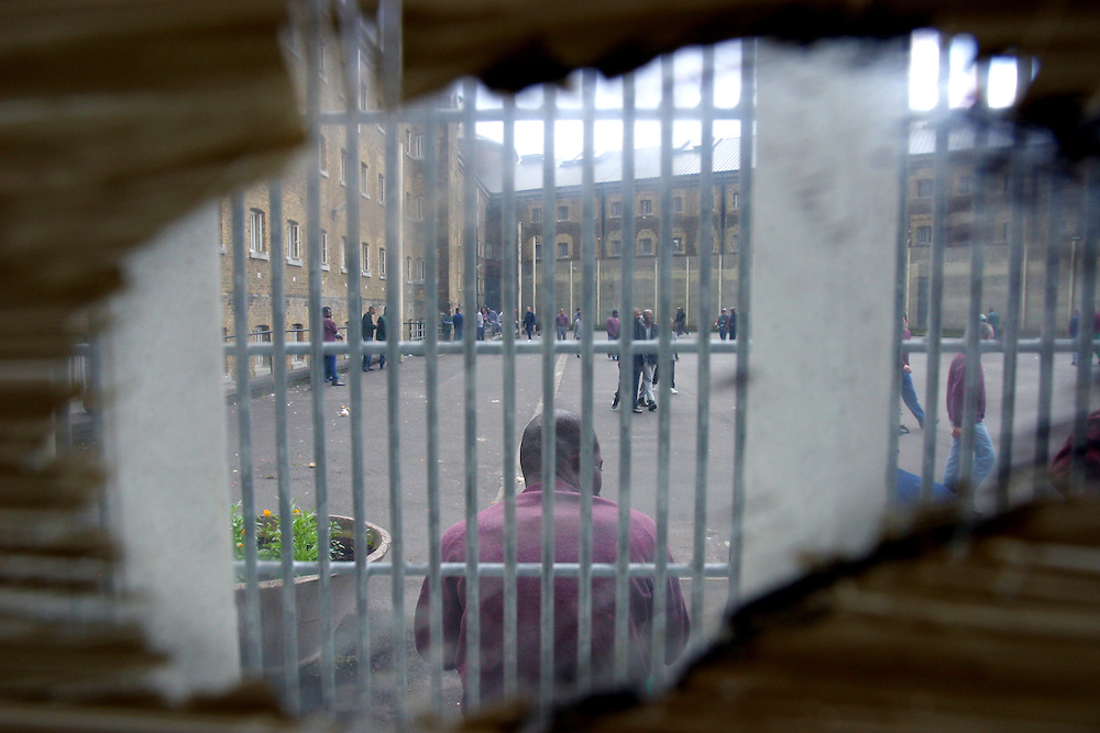 Looking out onto the exercise yard from inside the prison. HMP Wandsworth, London, United Kingdom